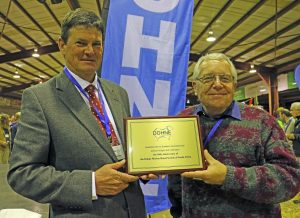 South African Dohne Merino Breed Society president Koos Vosloo and manager Kobus Delport were presented with a plaque by the Australian Dohne Breeders Association commemorating 50 years since formation of the South African body.