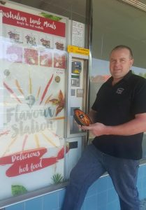 Sutton STreet Store co-owner Peter Nolan with the lamb meal vending machine.